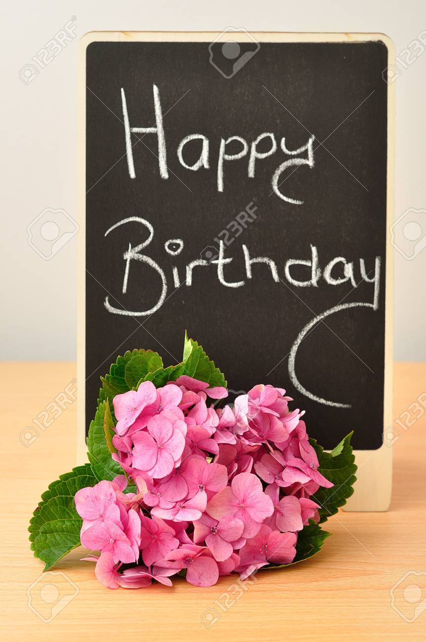 A blackboard with a happy birthday message and hydrangeas stock a blackboard with a happy birthday message and hydrangeas stock photo 72939198 m4hsunfo
