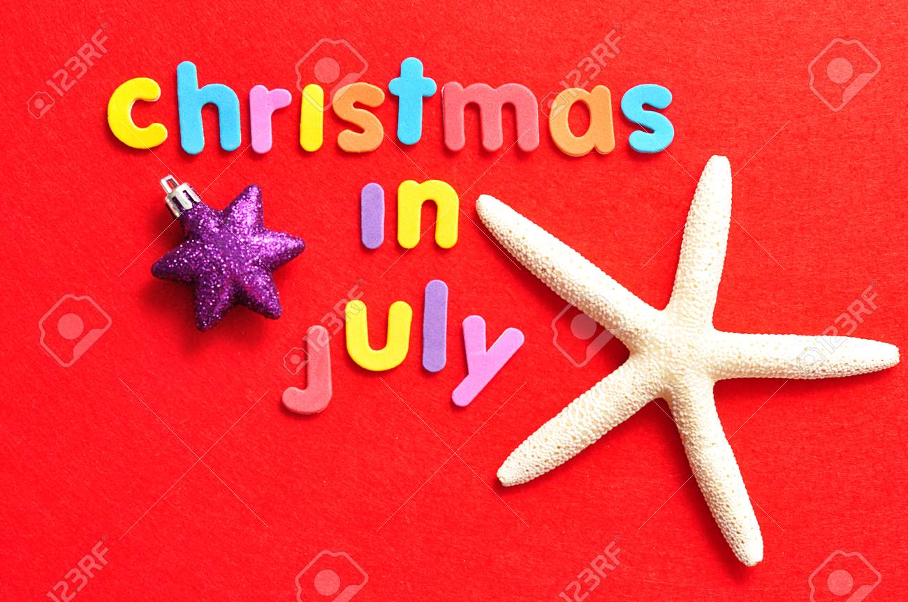 Christmas In July Background Images.The Words Christmas In July In Colorful Letters On A Red Background