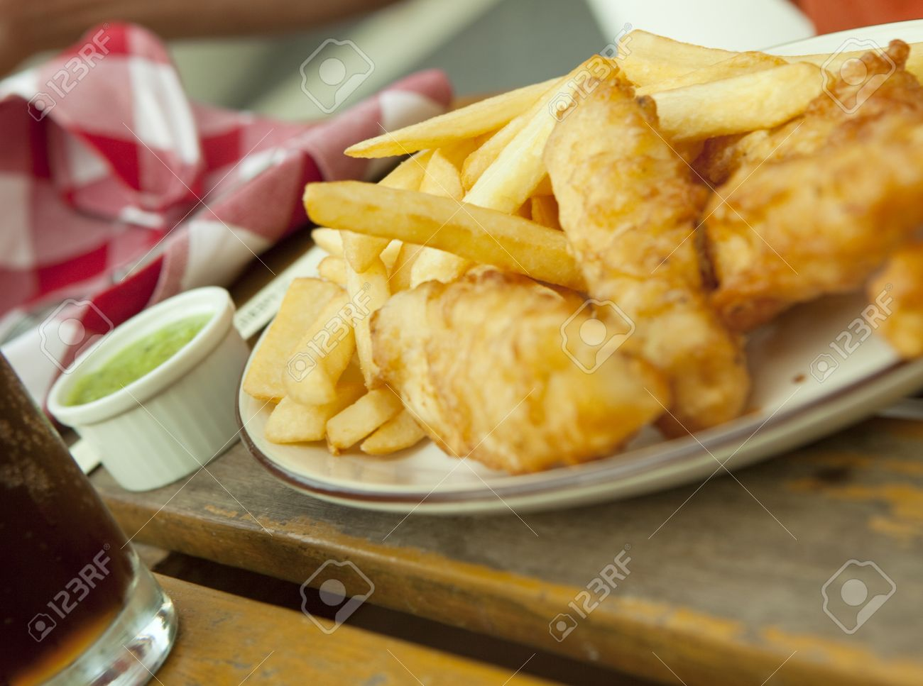 Fish and chips. Traditional british snack on the wooden table Stock Photo - 12751026