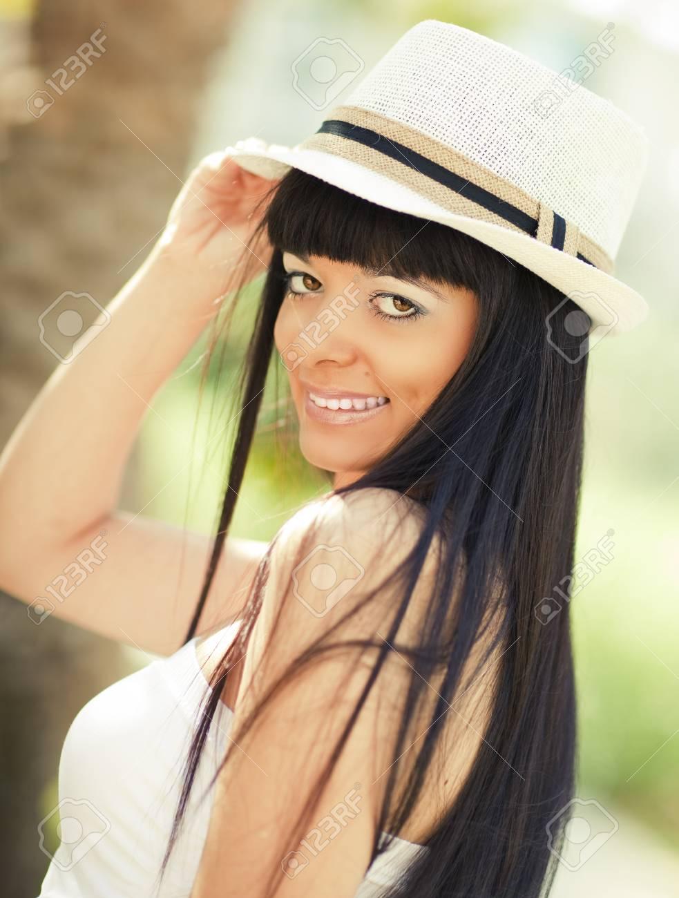 Young beautiful girl looking at camera and smiling Stock Photo - 13510947