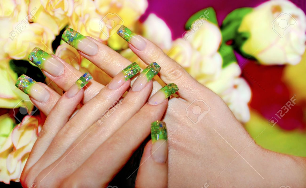 Acrylic nails with the help of pieces of green acrylic and Golden sand Stock Photo - 16192341