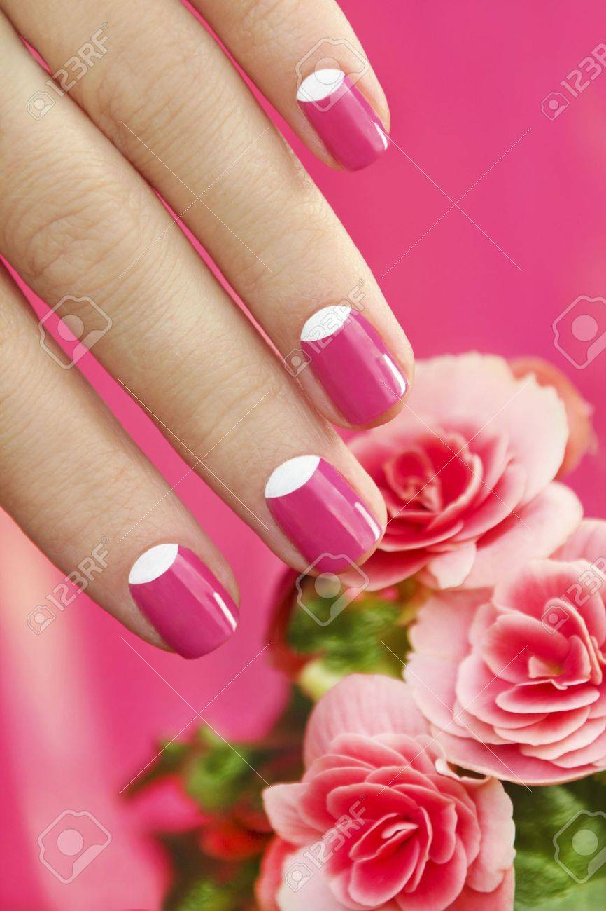 Beautiful Manicures On Short Nails Woman With A Flower On A Pink ...