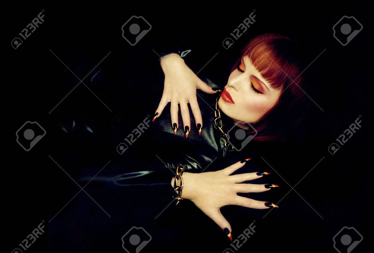 A Beautiful Young Girl With Orange Hair,red Lips And Long Nails ...