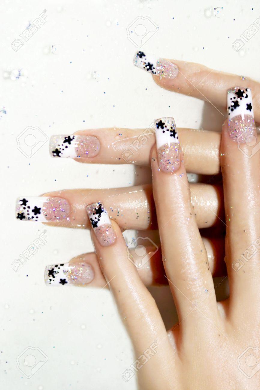 Aquarium design on transparent nails with black stars inside