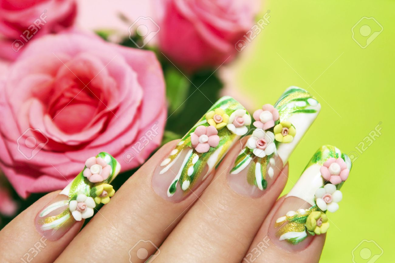 Art Nail Design With Acrylic Roses On The French Manicure On.. Stock ...