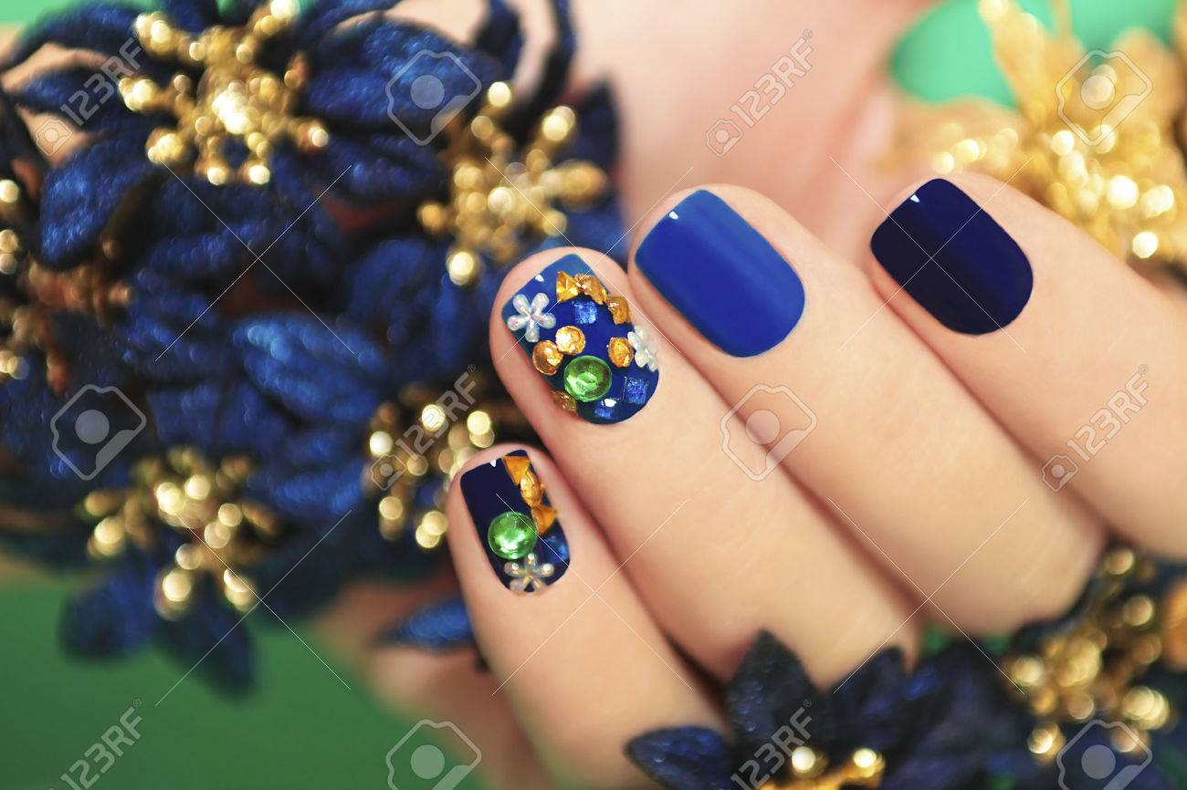 Nails Of Women Covered In Blue Lacquer Different Shades With.. Stock ...