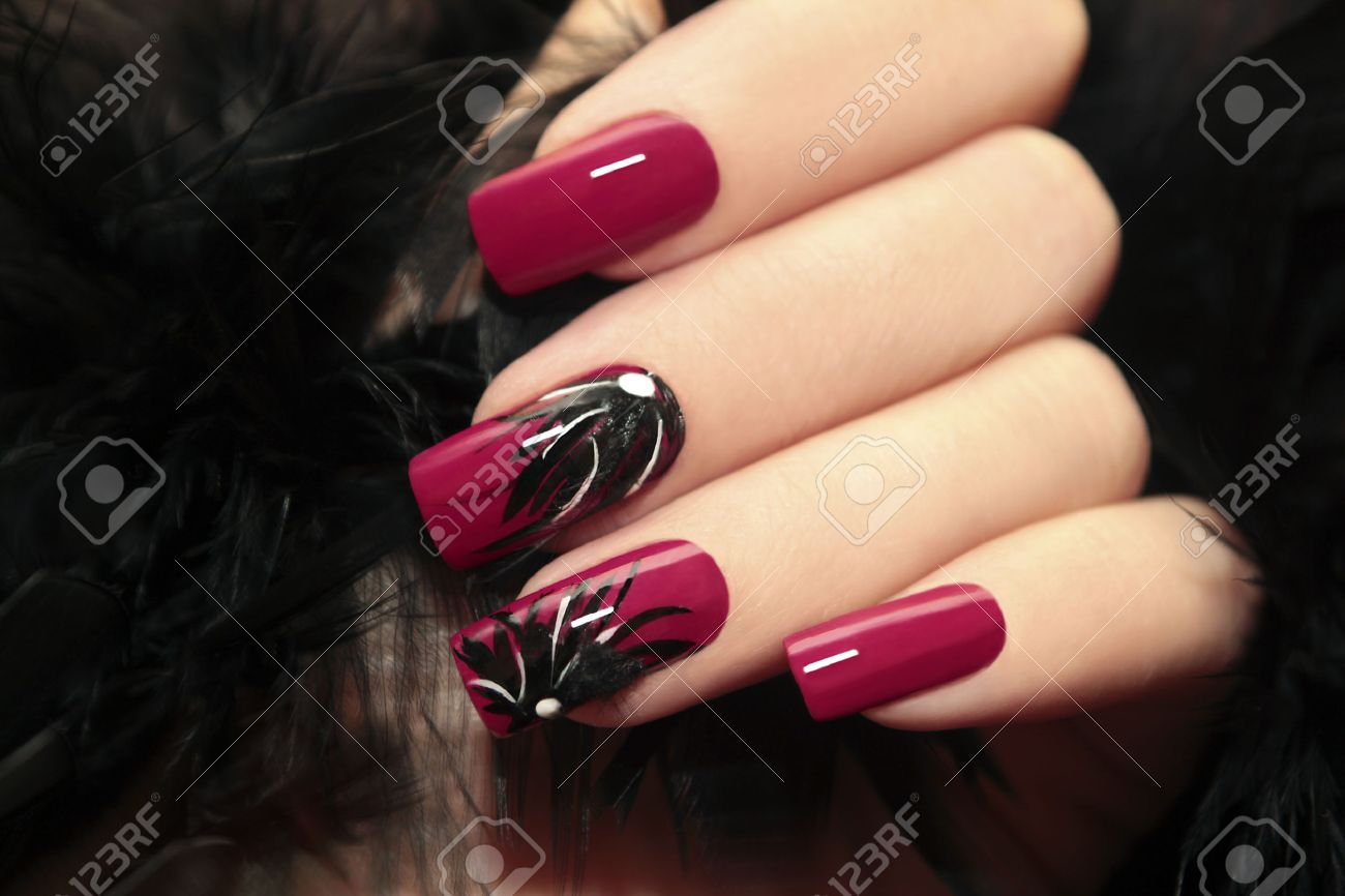 Burgundy Manicure With Design On The Nails And Feathers. Stock Photo ...
