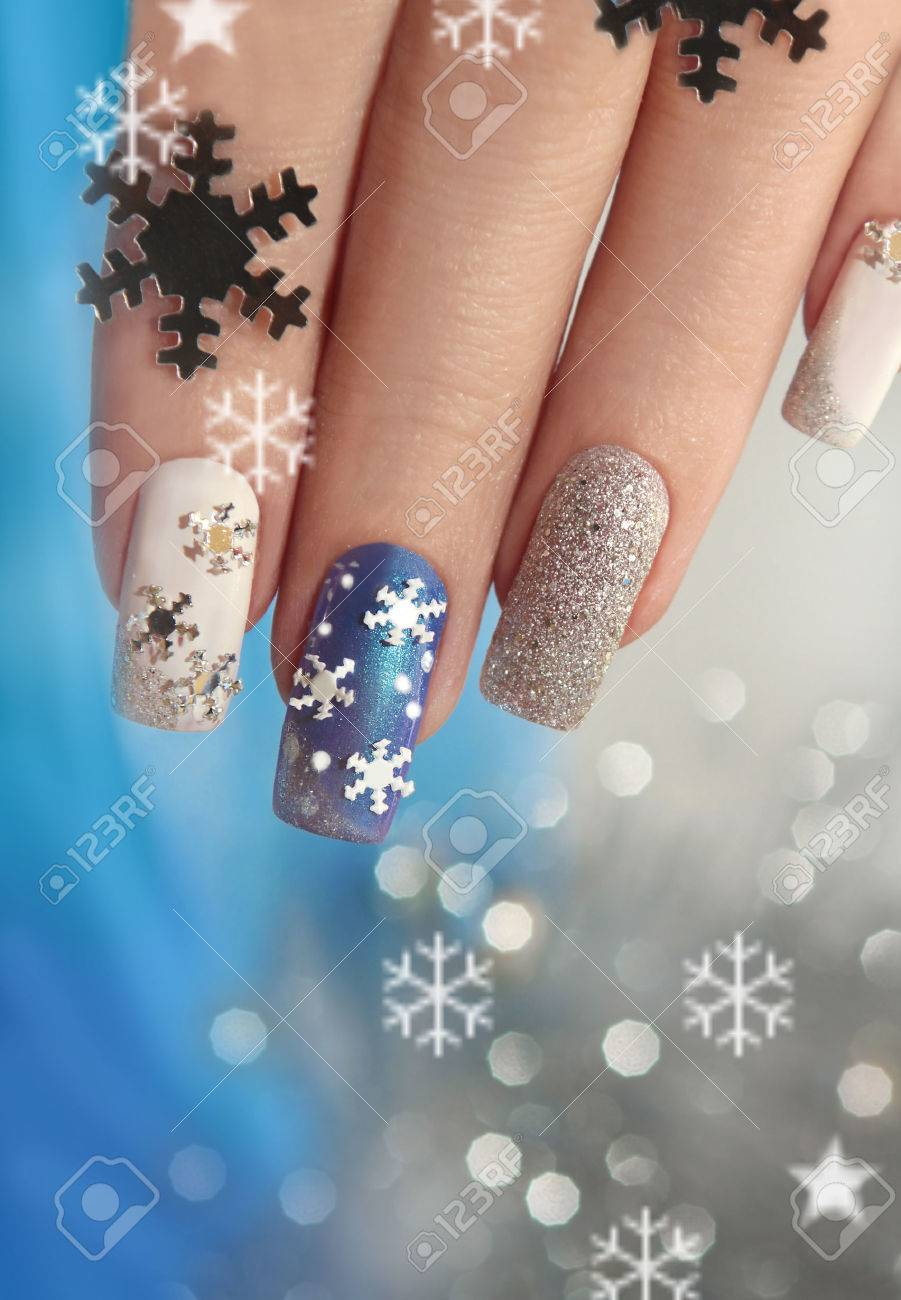 Manicure With Snowflakes On Your Nails With Colored Lacquers.. Stock ...
