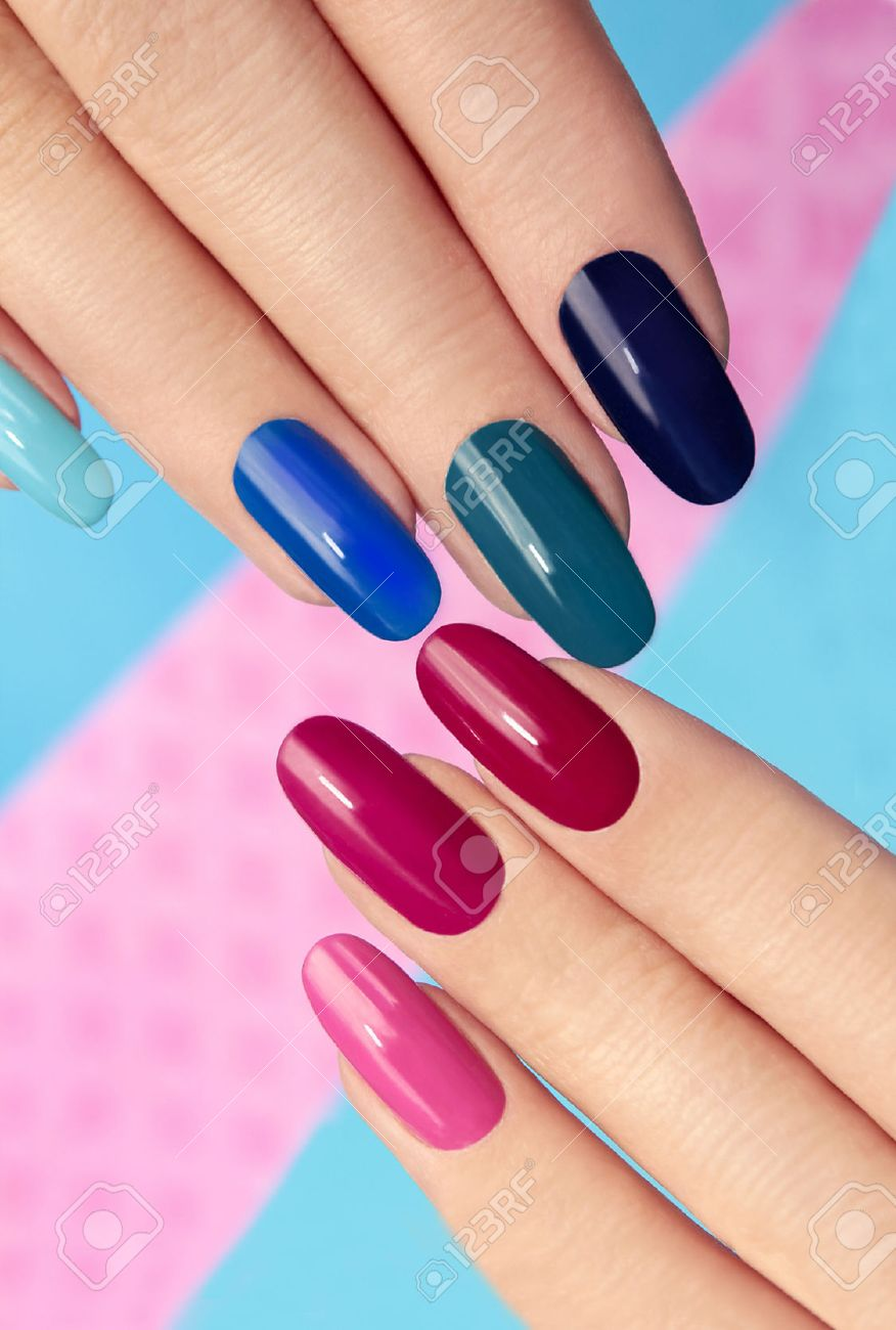 Blue Pink Nail Polish On Long Nails On A Colored Background. Stock ...