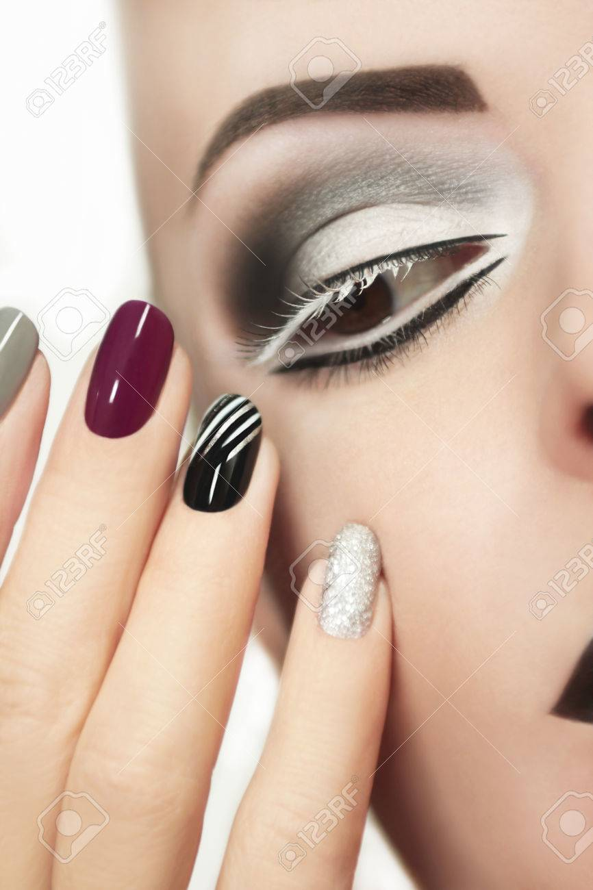 Makeup And Manicure With Grey Shades And Striped Nail Design Stock