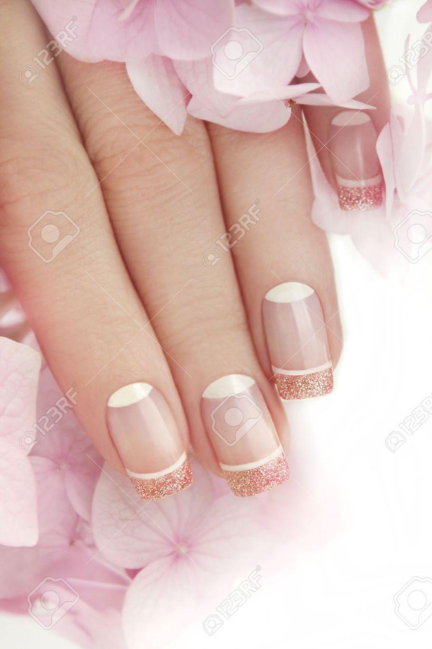 French Manicure With Glitter Inside And White Nail Varnish On ...
