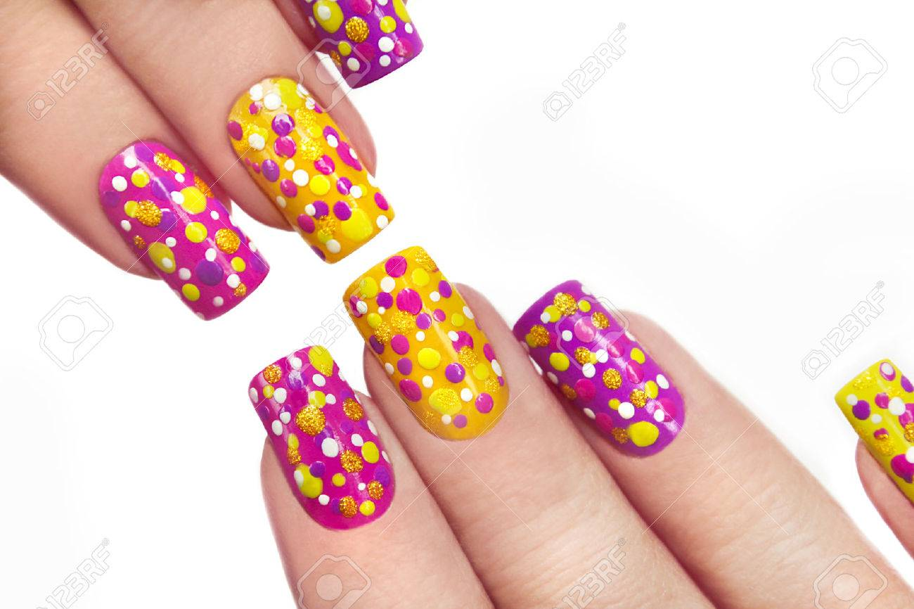 Multicolored manicure with dots of different shapes and colors on a white background. - 54335779