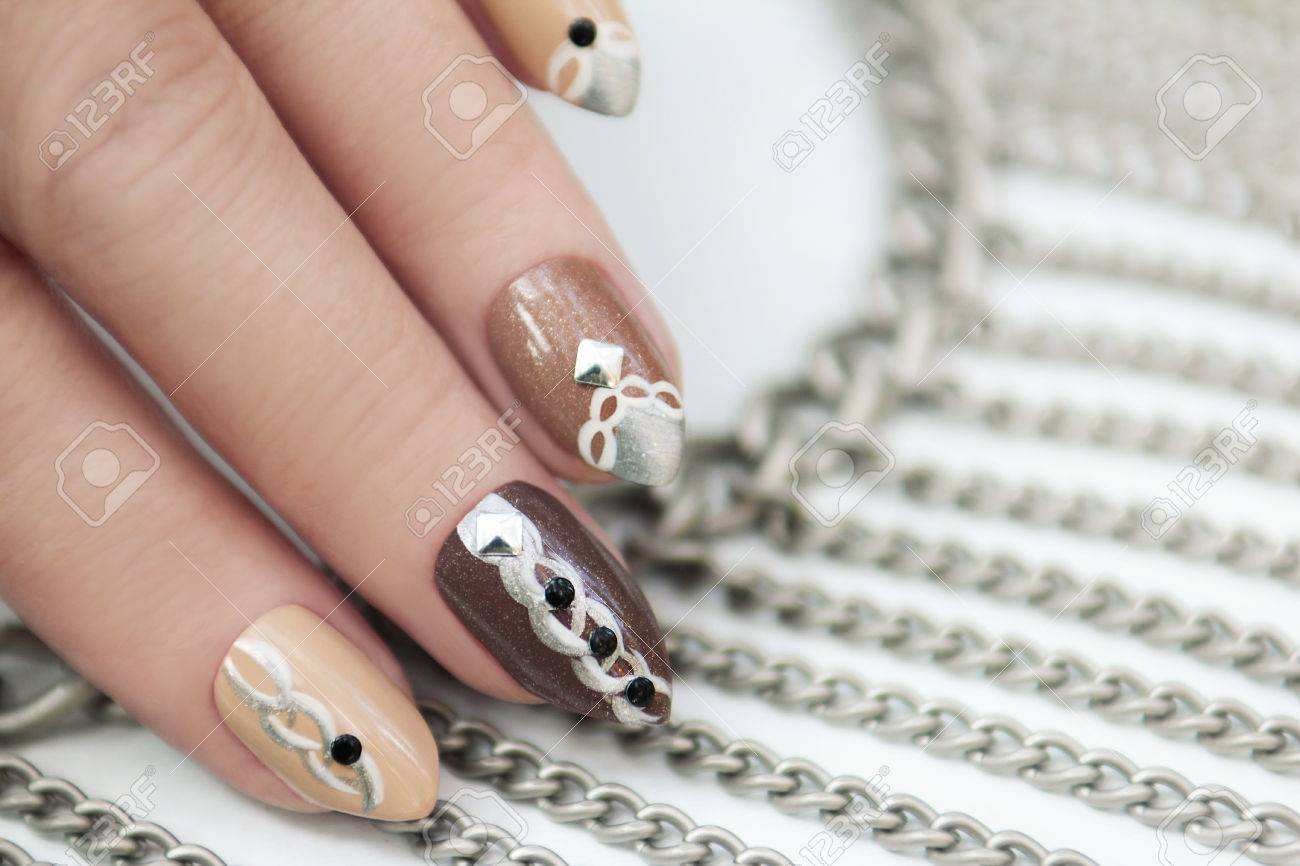Manicure In Brown Shades Of Nail Polish Designed In The Form.. Stock ...