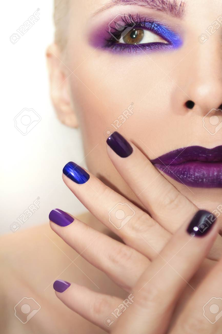 Blue Purple Fashion Multicolored Manicure And Makeup On A Woman