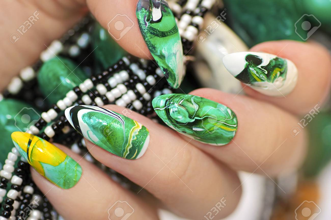Stone Nail Design In White And Green Colors With Veins Of Dark ...