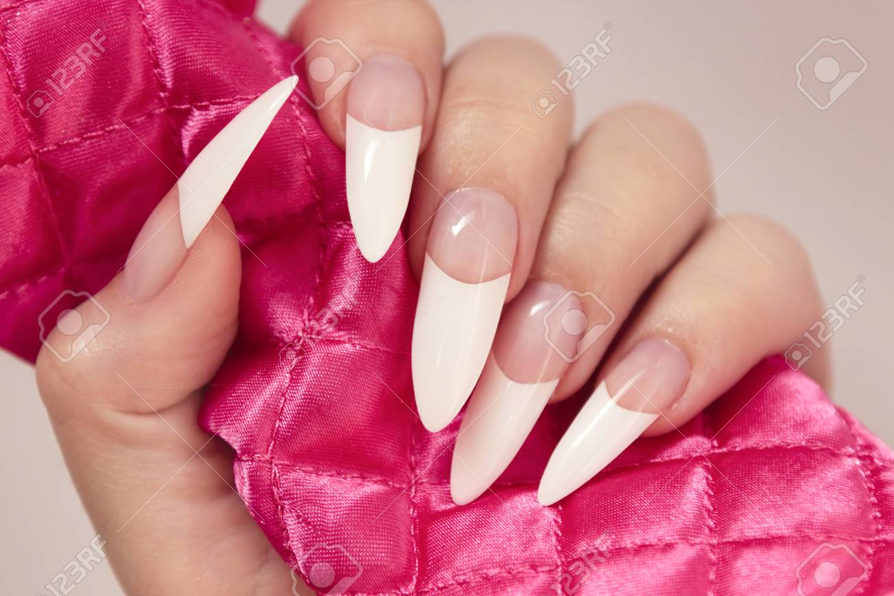 Long French manicure on the female hand close-up.Nail art.Nail..