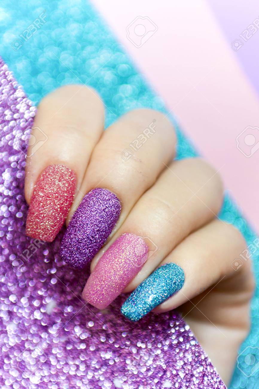 Design on long nails from multicolored sequin closeup.Nail art. Stock Photo  - 97293920 - Design On Long Nails From Multicolored Sequin Closeup.Nail Art