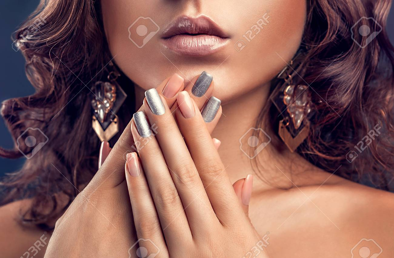 Beautiful woman with pink and silver manicure and perfect makeup - 93161342
