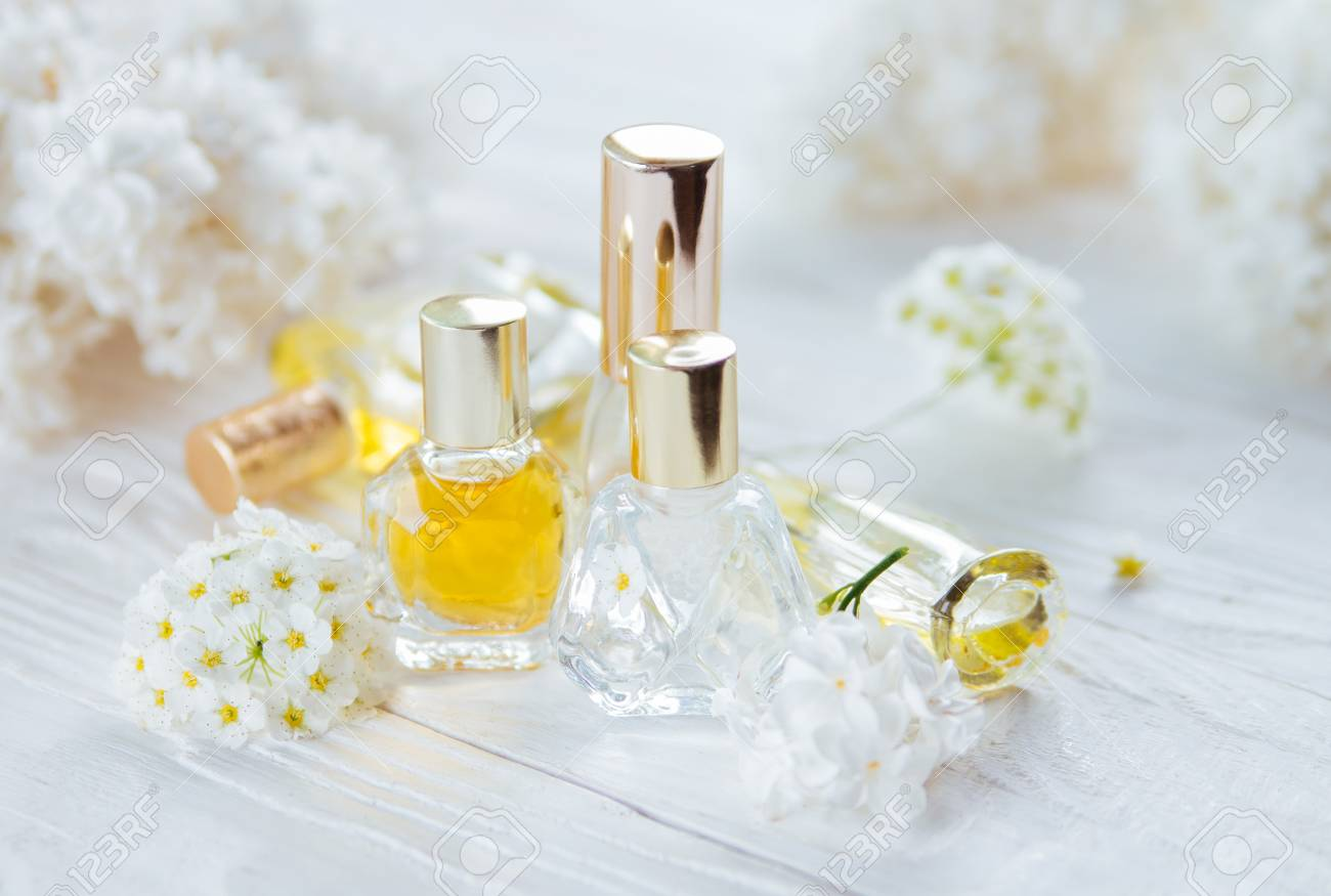 Bottles of perfume with white flowers on wooden background stock bottles of perfume with white flowers on wooden background stock photo 95960583 mightylinksfo