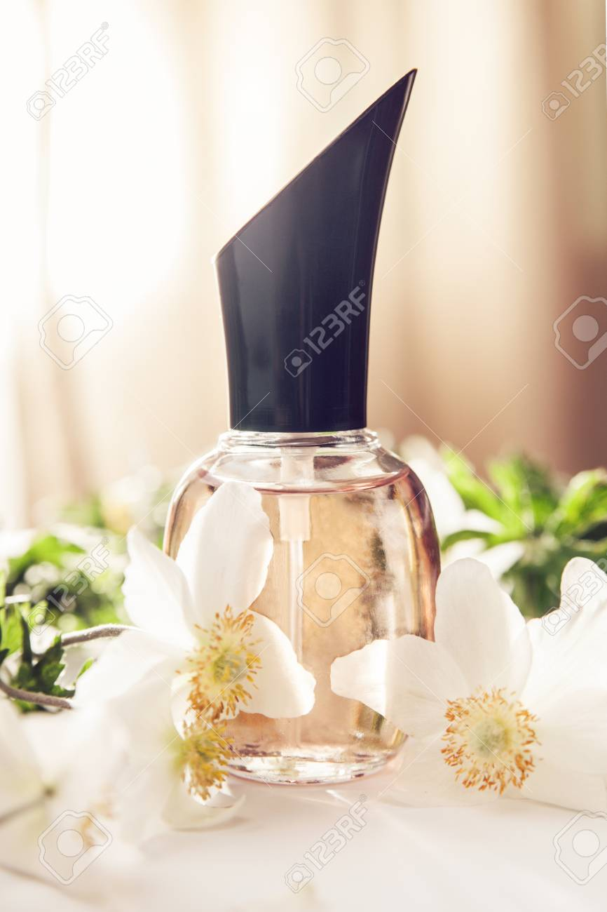 Bottle Of Perfume With White Flowers On Beige Background Floral