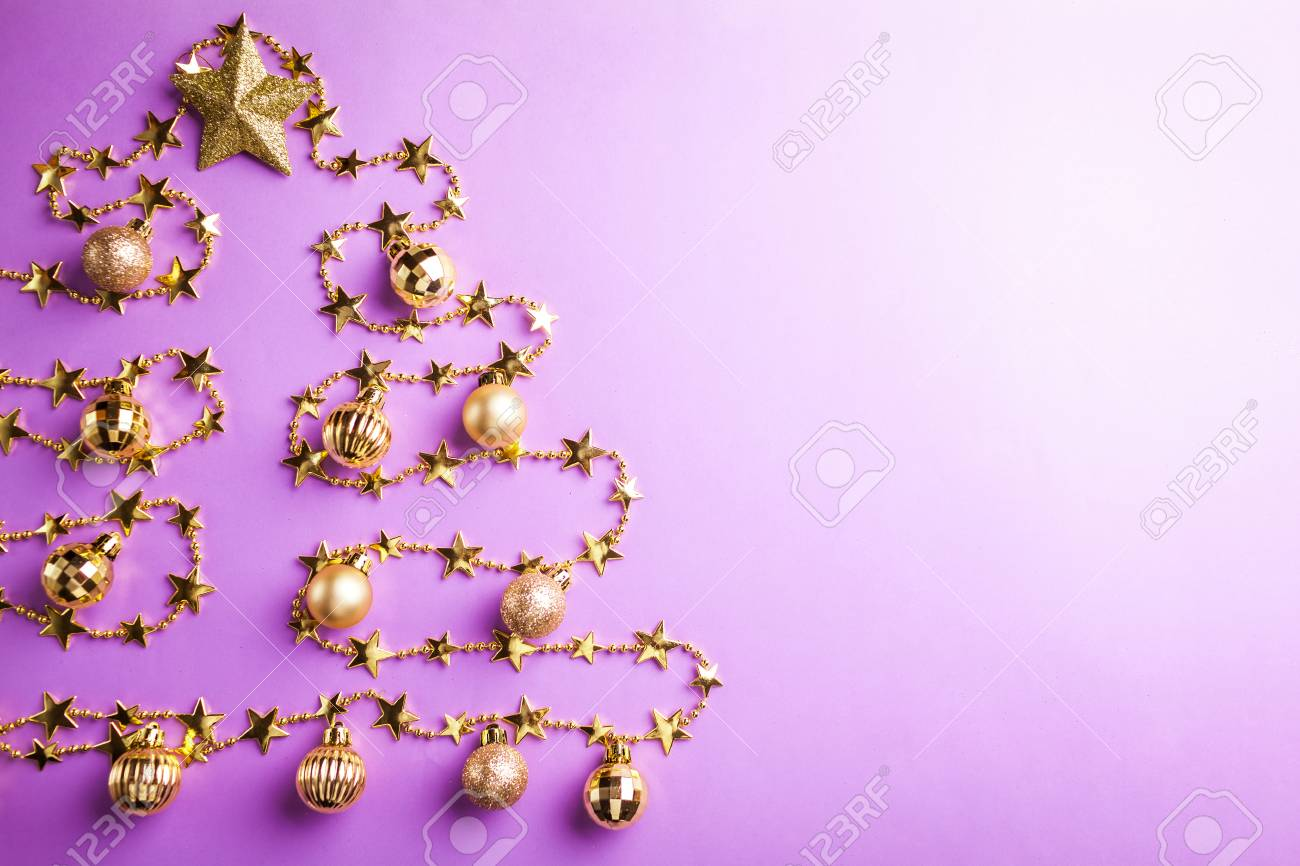 purple christmas and new year background with christmas tree made of toys copy space stock