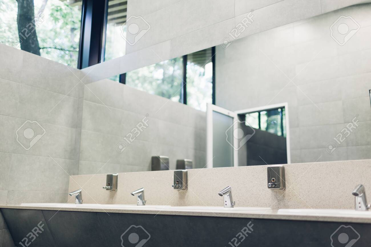 . Modern interior design in public toilet  New sinks  taps with