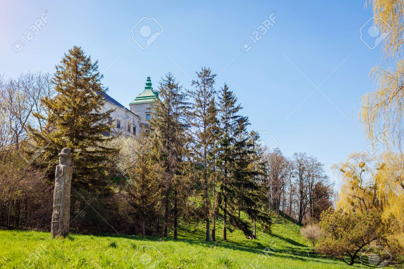 View of Olesko Castle from spring garden. Ancient architecture, landmarks, places of interest in Western Ukraine. Traveling in Lviv region - 168610429