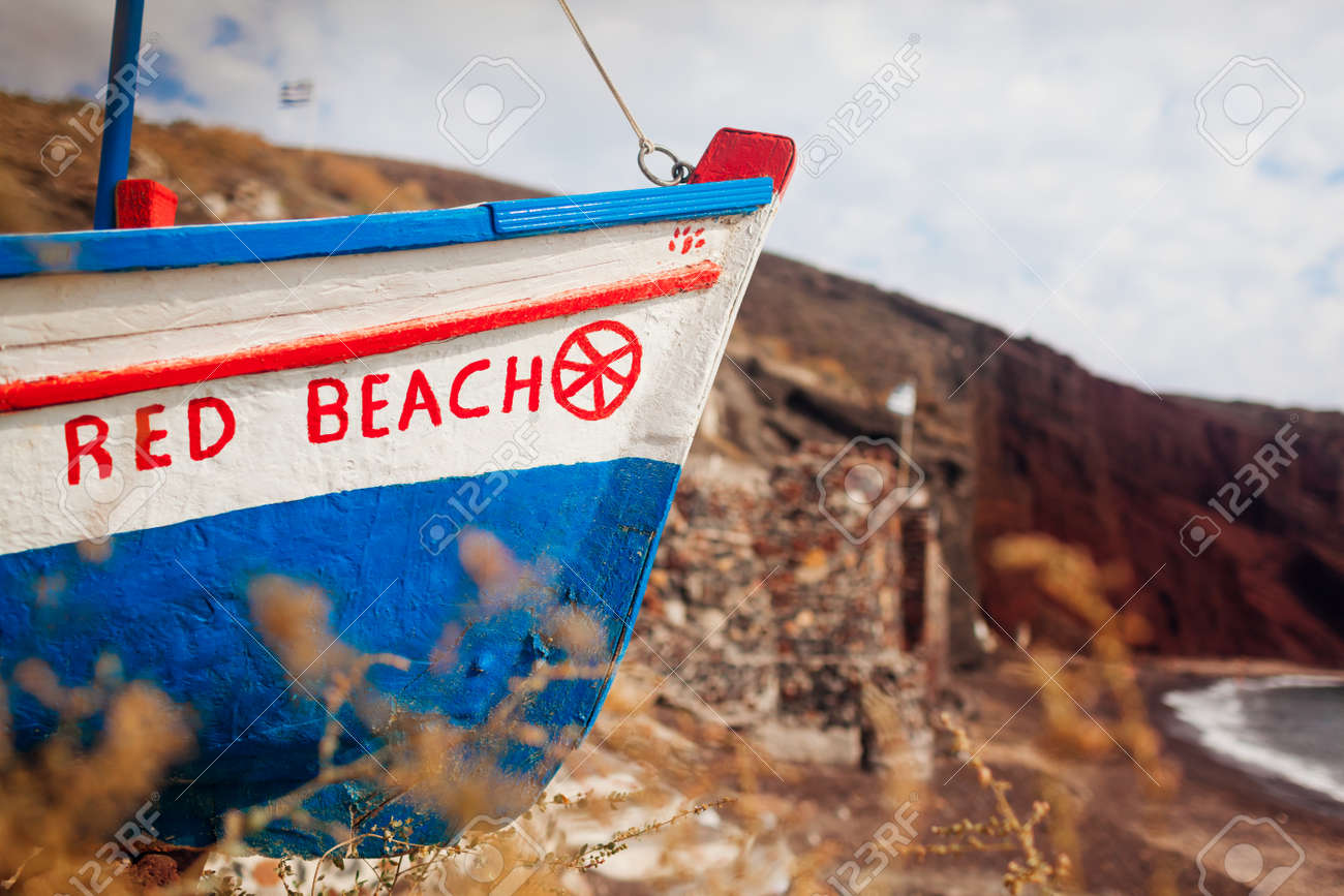 Boat with Red beach writing on Santorini island, Greece on seashore at summer. Close up - 171314617