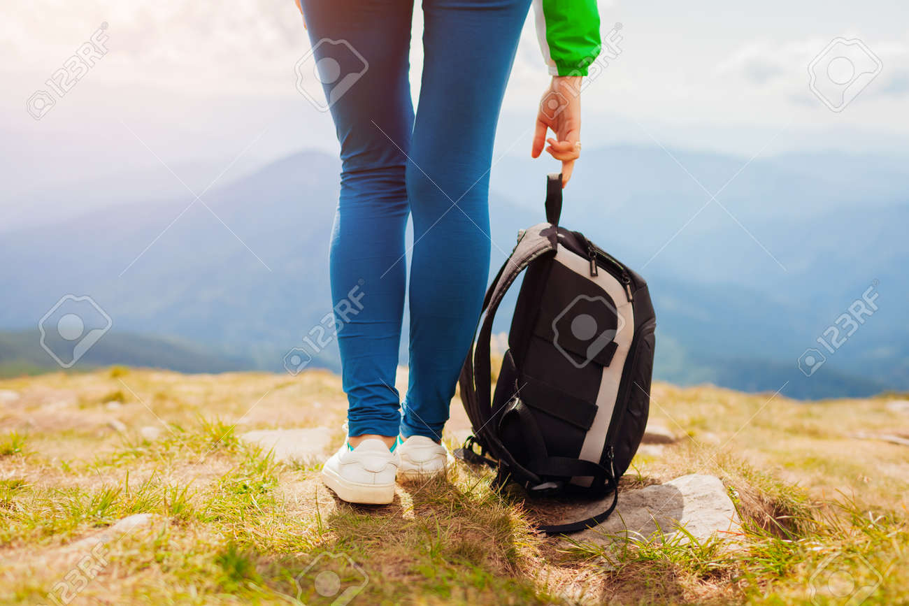 Hiking in Carpathian mountains. Hiker woman carrying backpack enjoying landscape. Close up of legs. Traveling in summer Ukraine - 173065488