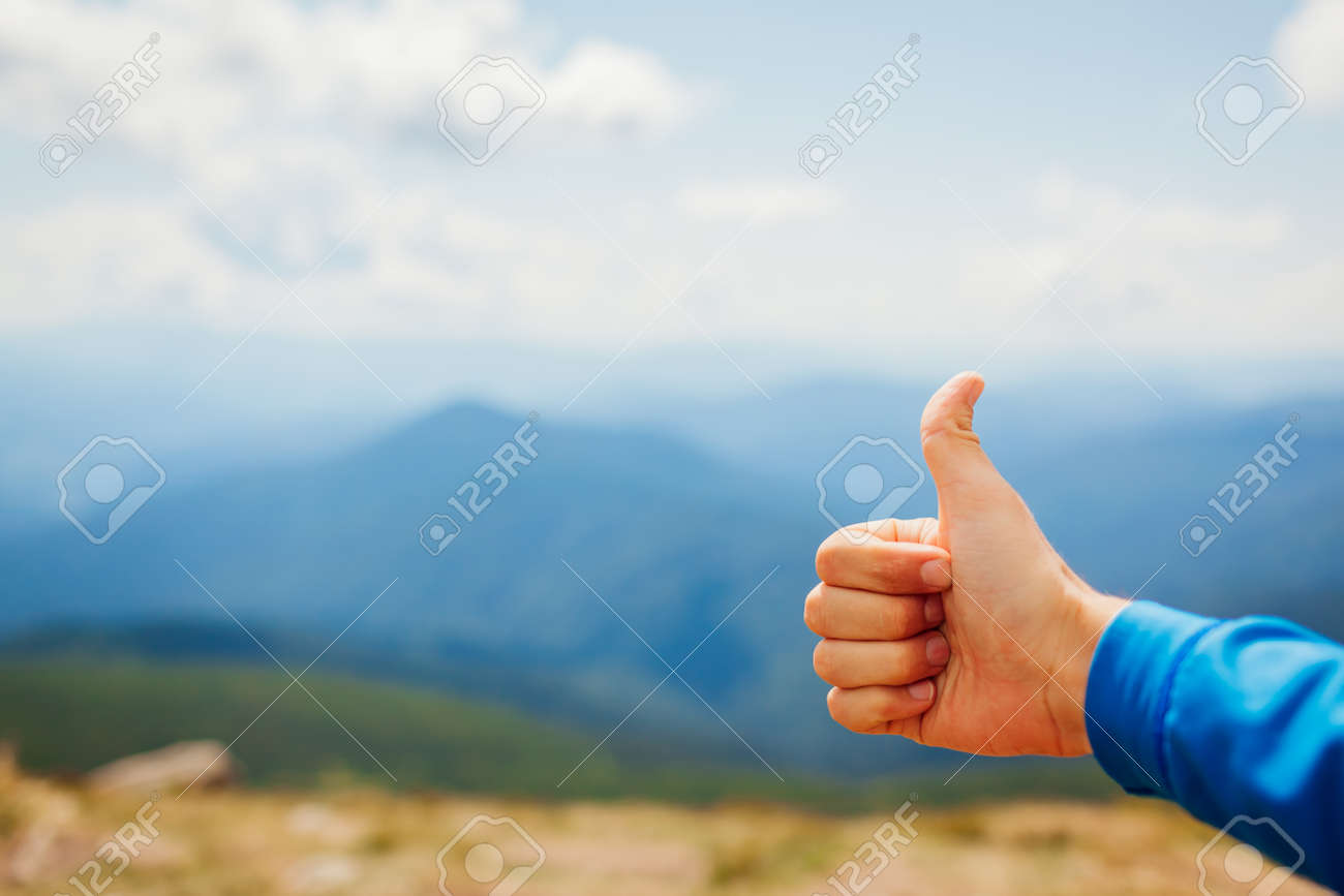 Man hiker giving thumb up on mountain landscape background. Active healthy sportive lifestyle. Close up. Traveling and tourism concept - 173097644