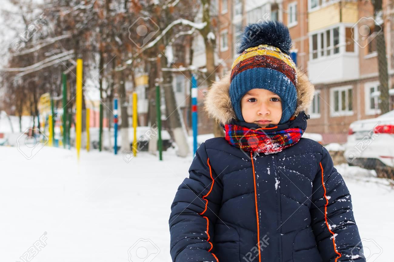 boy walks in the winter outdoors - 113936522