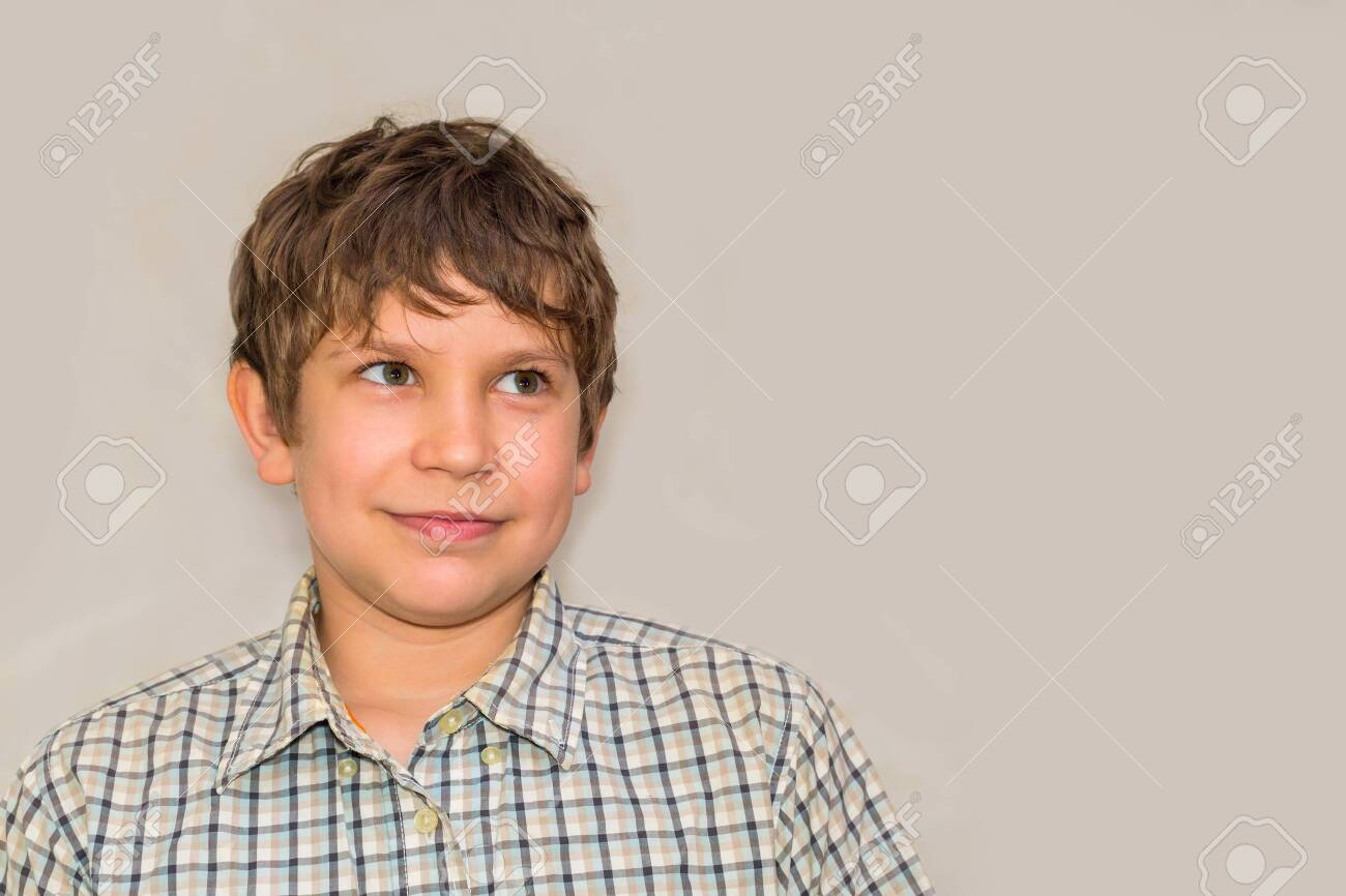 portrait of a teenage boy on a gray background - 130103682