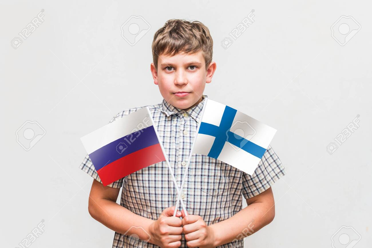 teen boy holds the flags of the - 130104017