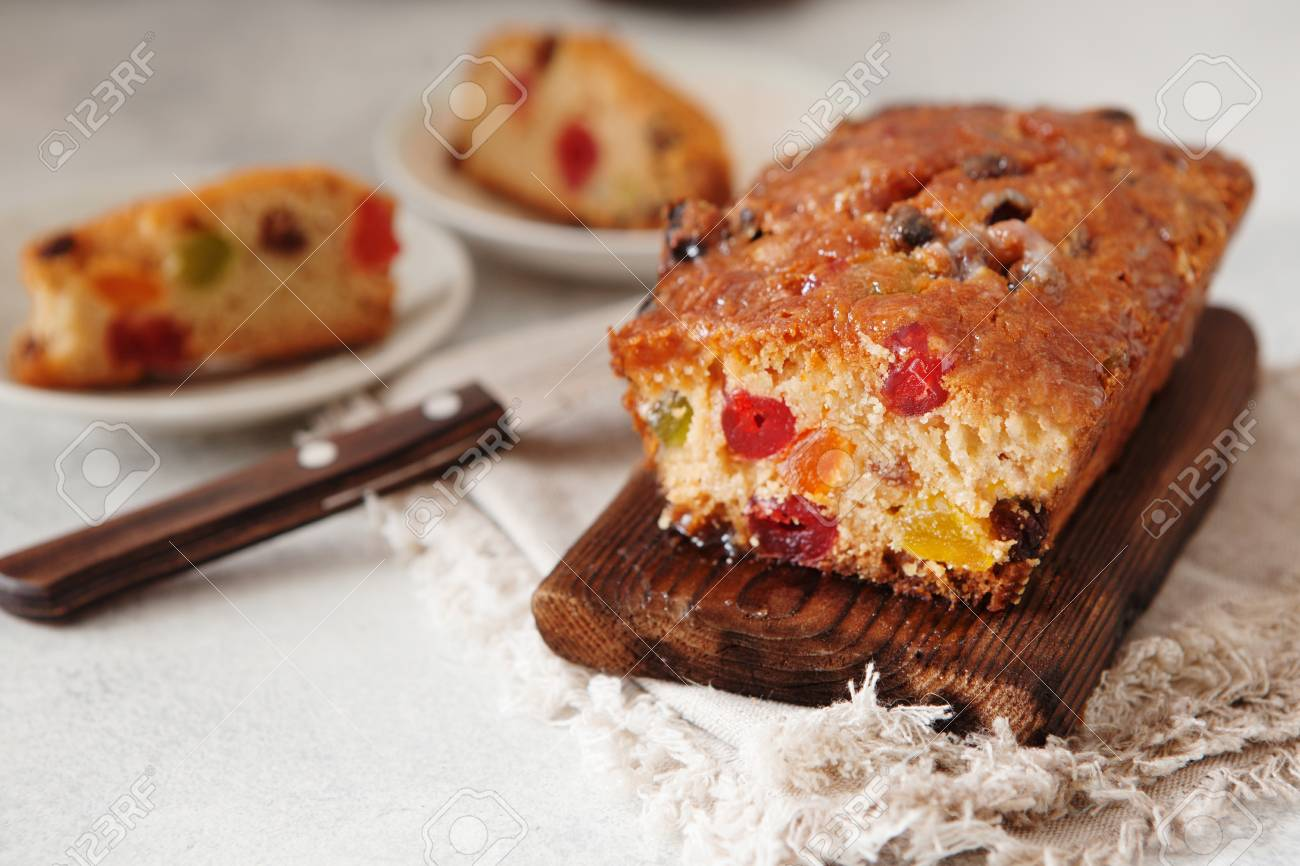 stock photo traditional fruit cake pudding with dried fruits on wooden board copy space