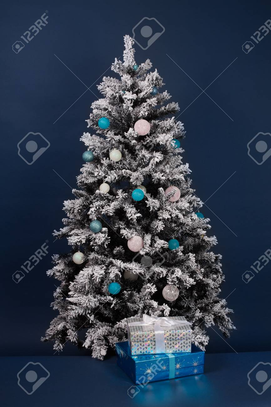Christmas Tree Decoration On Dark Blue With Gift Boxes Stock Photo Picture And Royalty Free Image Image 49189816