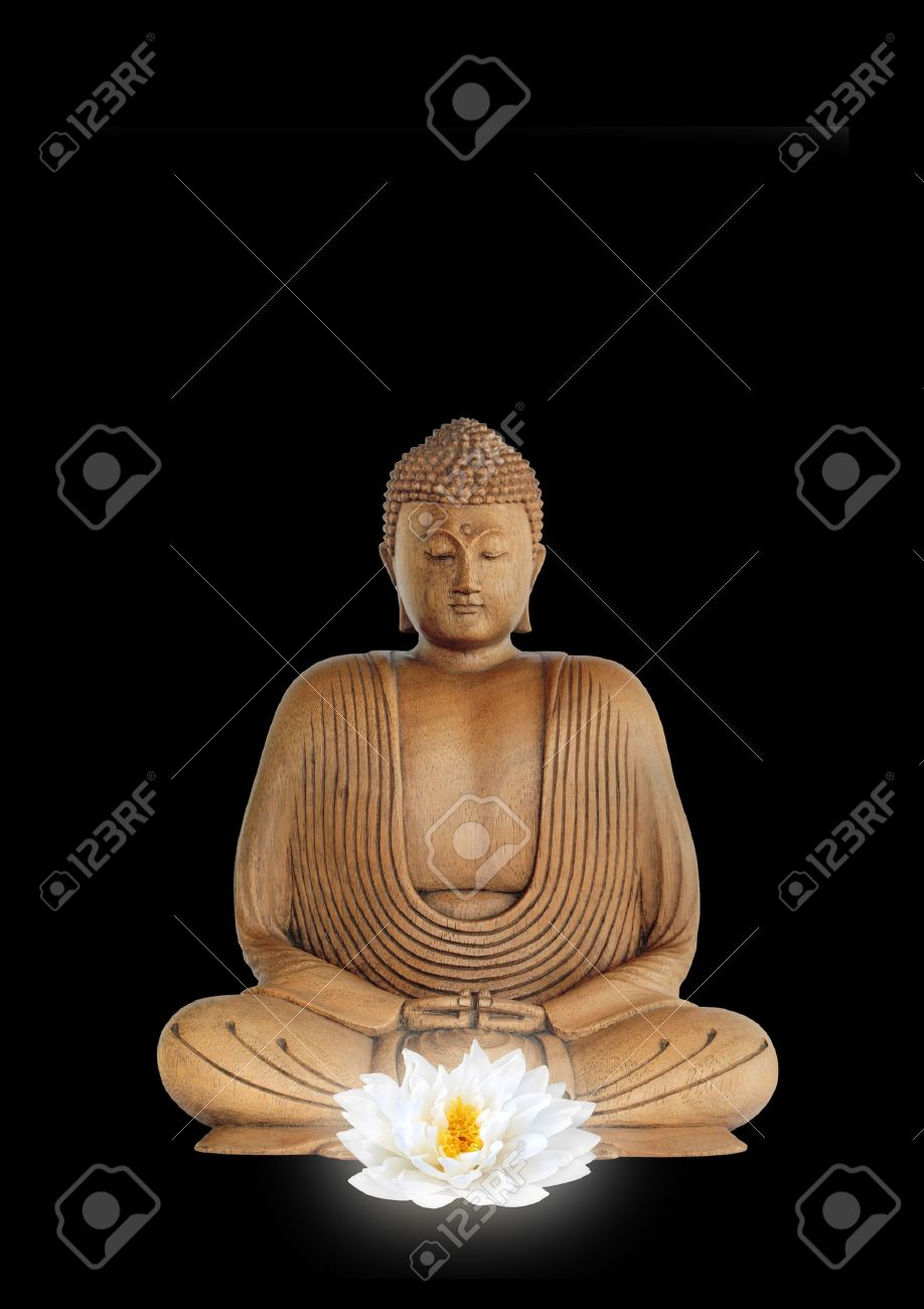 Buddha smiling, with eyes closed in prayer with a glowing white lotus lily flower in the foreground, over black background. Stock Photo - 3658046
