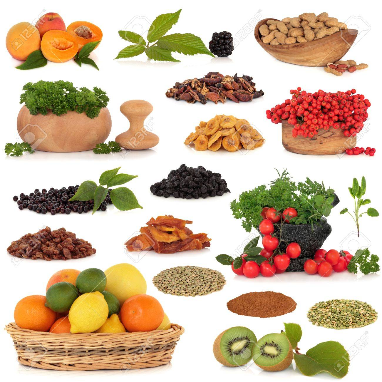 Healthy super food collection of fresh and dried fruit, nuts, herbs, spices, and pulses, very high in antioxidants and vitamins, isolated over white background. Stock Photo - 7103260