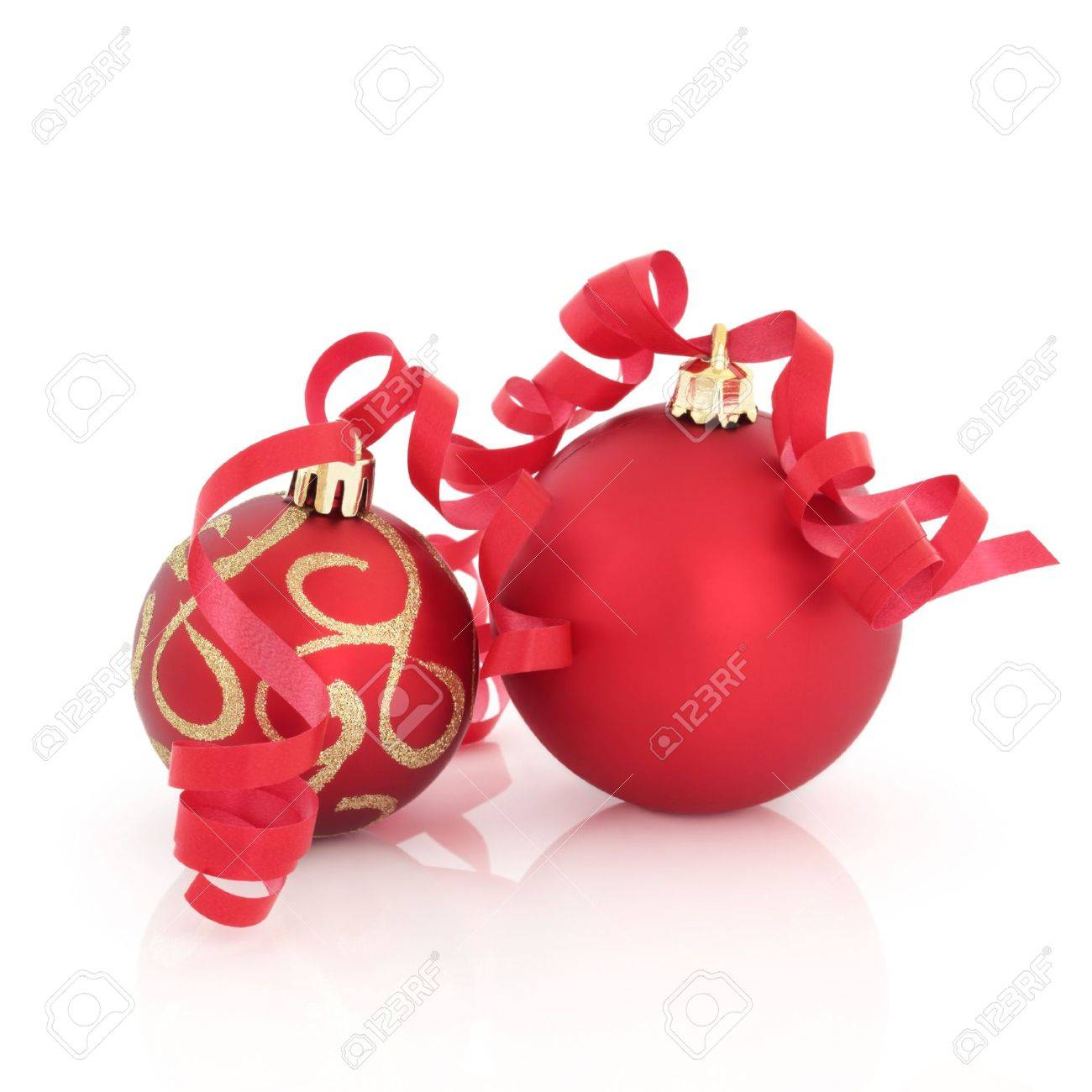 Red and gold christmas decorations with ribbon isolated over white background. Stock Photo - 7774722