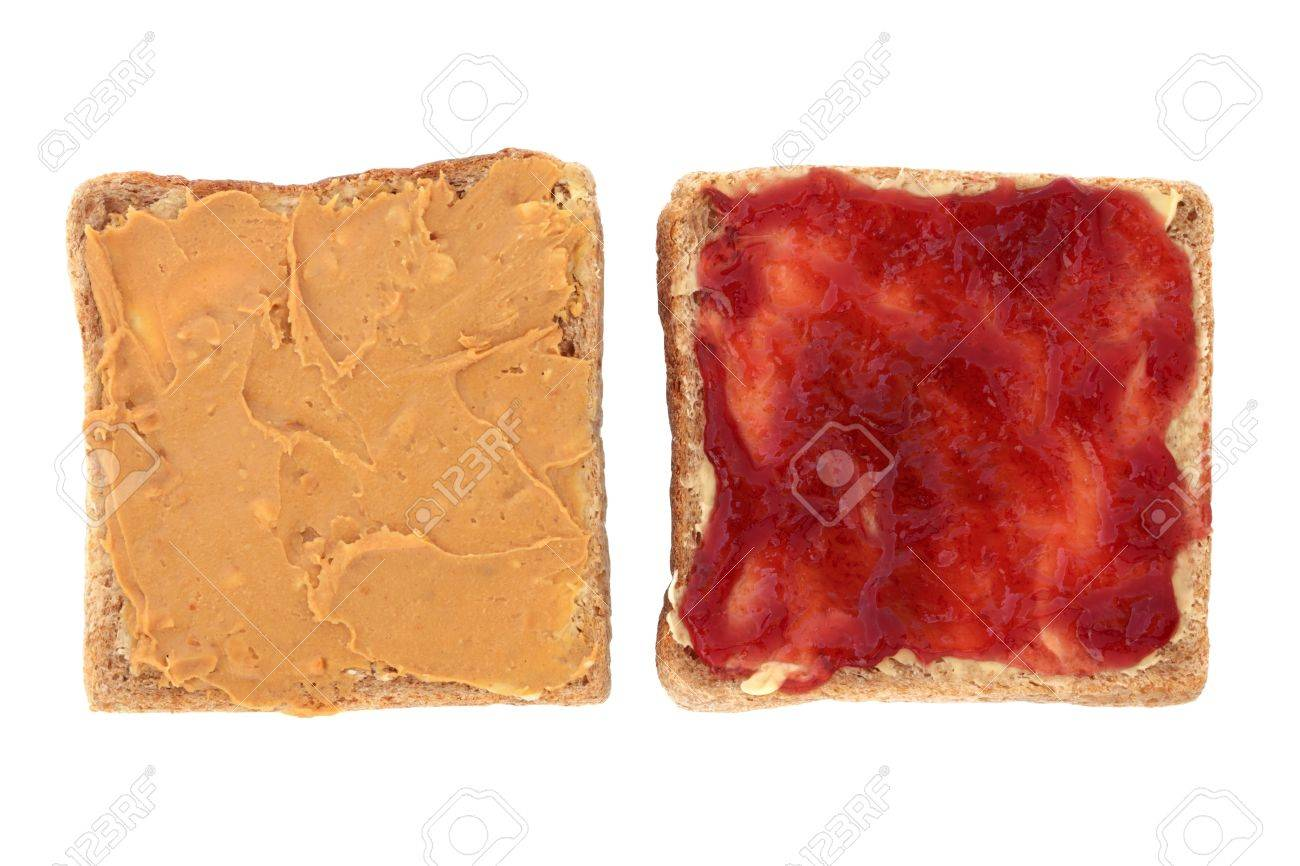 Peanut butter and raspberry jam open sandwich on sliced brown bread, over white background. Stock Photo - 9131351
