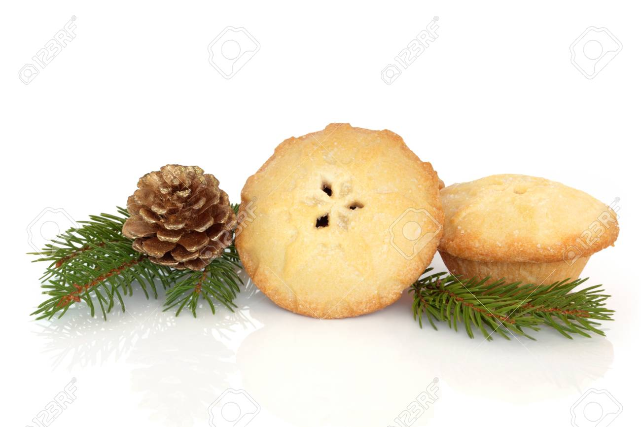Christmas mince pies with blue spruce pine leaf sprig and pine cone isolated over white background. Stock Photo - 10754123