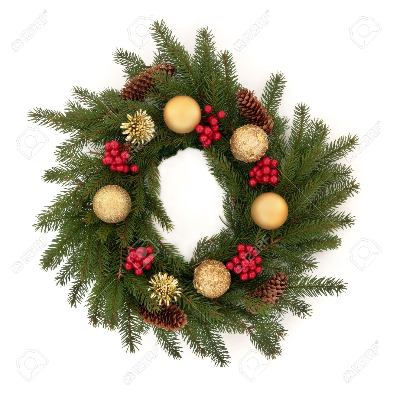 1ed47fa3183c ... isolated over white background. Christmas wreath of pine fir with red  holly berry clusters, pine cones and golden bauble