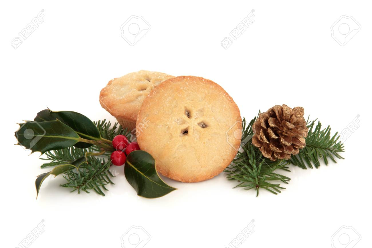 Mince pie cakes with holly berry, spruce leaf sprig with pine cone over white background. Stock Photo - 10994158