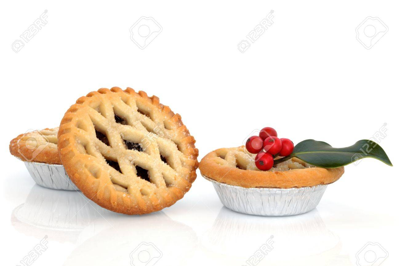 Christmas mince pie group with holly berry leaf sprig isolated over white background. Stock Photo - 11093478