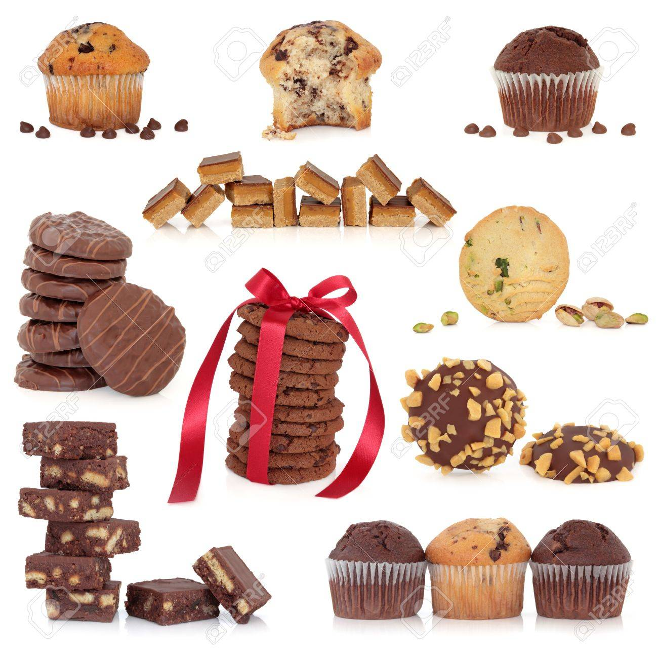 Large collection of chocolate cookies, biscuits, candy and muffin cakes isolated over white background Stock Photo - 13373293