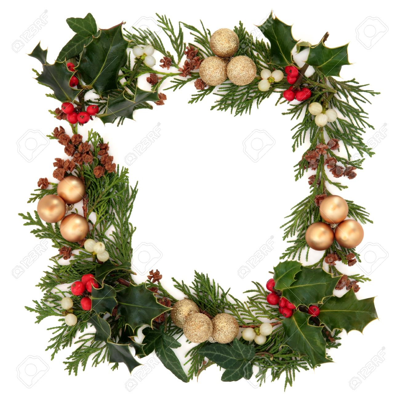 christmas decorative border of holly mistletoe ivy cedar and gold baubles over white