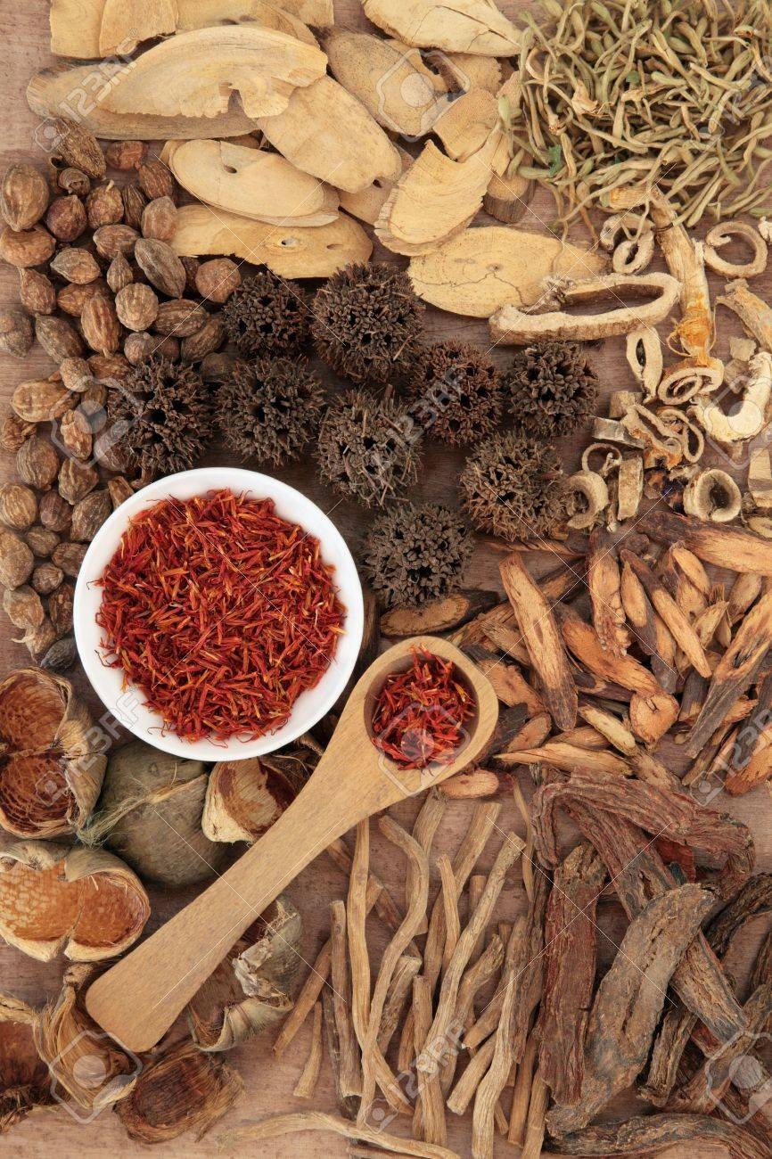 Traditional chinese herbal medicine selection over papyrus background Stock Photo - 17699509