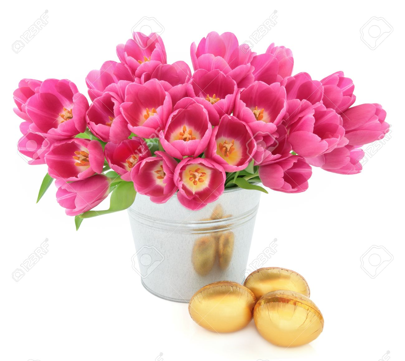 Tulip flower arrangement in a metal vase with easter egg group tulip flower arrangement in a metal vase with easter egg group over white background stock photo reviewsmspy