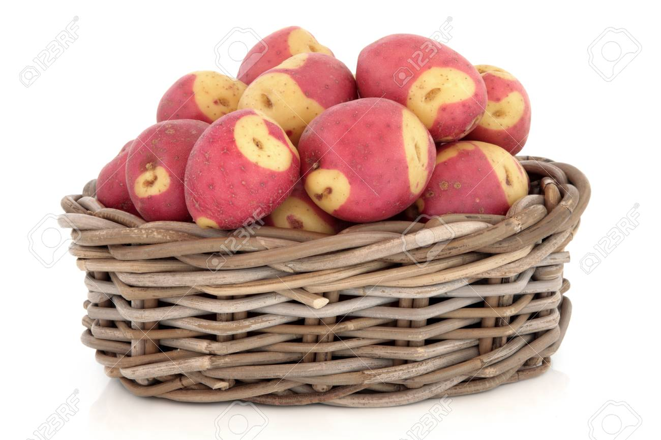 Apache potato selection in a rustic wicker basket over white background Stock Photo - 18020700