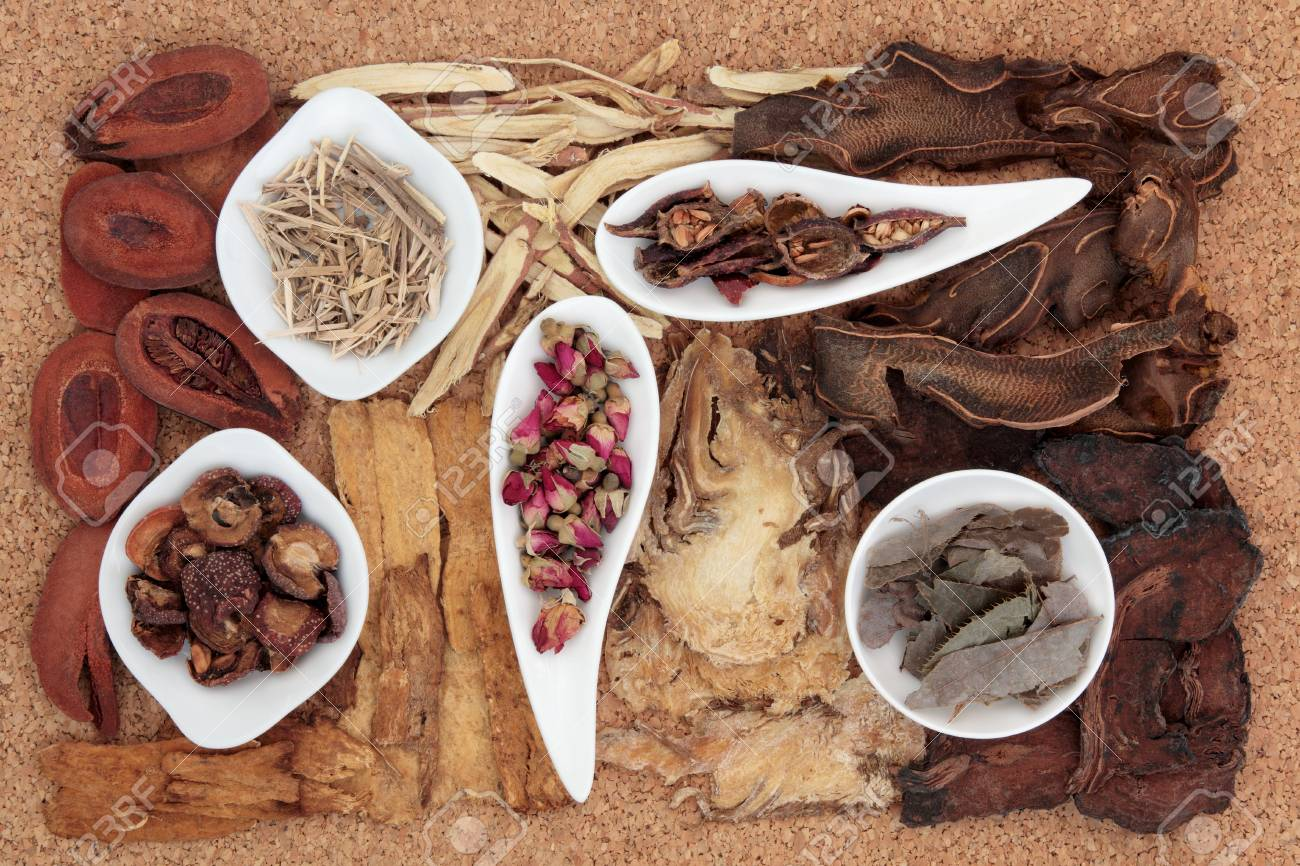 Chinese traditional herbal medicine selection over cork background Stock Photo - 19021722