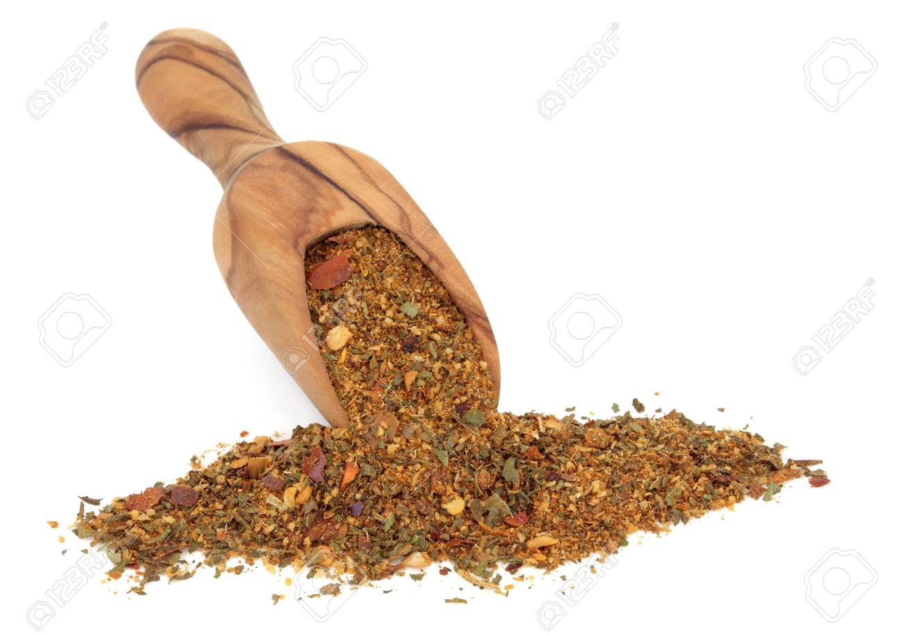 Harissa spice powder in an olive wood scoop over white background Stock Photo - 19136244